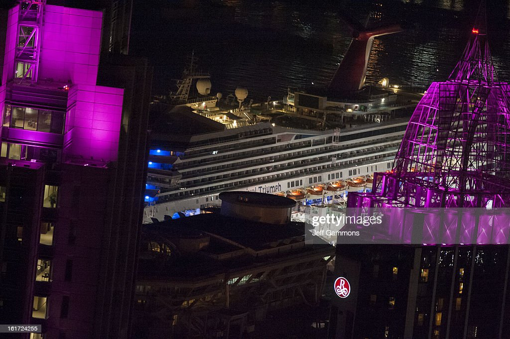 The docked Carnival Triumph, the crippled cruise liner that limped into port is shown February 14, 2013 in Mobile, Alabama. An engine fire on February 10 left the ship and its 4,000 passengers without power and with scarce food. While people onboard reported toilets that wouldn't work, the ship was restocked with food during the days it was being towed through the Gulf of Mexico. According to reports, a few dozen people awaited the ship's arrival in Mobile, covered live by cable news network CNN.