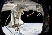 February 27, 2011 - The docked space shuttle Discovery (STS-133) and the Canadian-built Dextre, also known as the Special Purpose Dextrous Manipulator (SPDM). The blackness of space and Earth's horizo