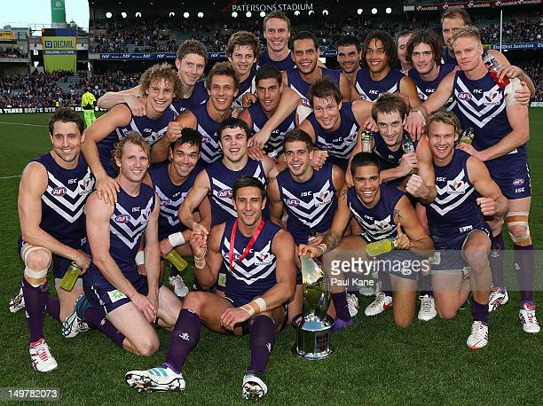 The Dockers pose with the Western Derby Trophy after winning the round 19 AFL match between the Fremantle Dockers and the West Coast Eagles at...