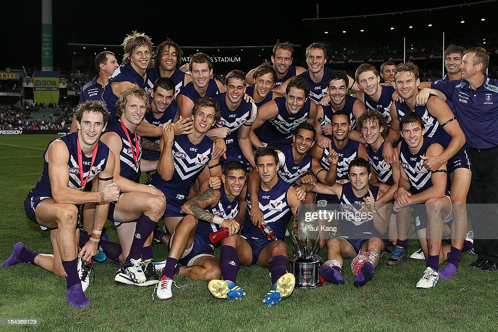 The Dockers pose with the Western Derby trophy after winning the round one AFL match between the Fremantle Dockers and the West Coast Eagles at Patersons Stadium on March 23, 2013 in Perth, Australia.
