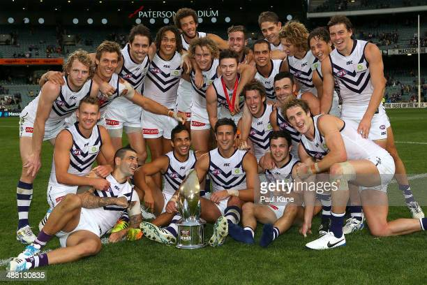 The Dockers pose with the Western Derby trophy after winning the round seven AFL match between the West Coast Eagles and the Fremantle Dockers at...
