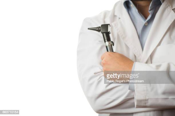 The doctor with an instrument