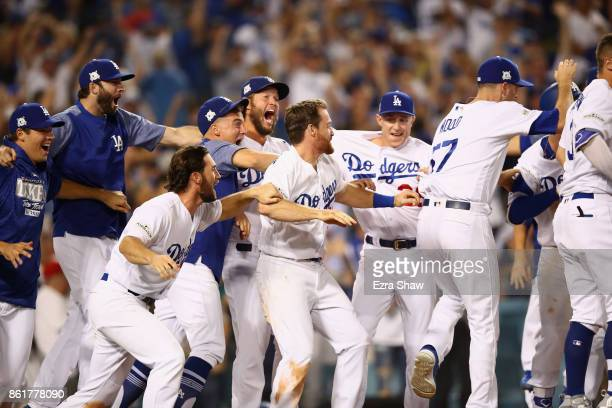 The Dodgers celebrate after Justin Turner of the Los Angeles Dodgers hit the winning home run in the bottom of the ninth inning making the score 41...