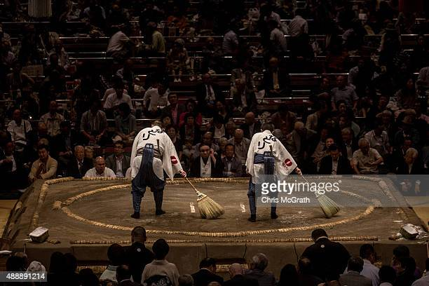 The dohyo is swept clean ahead of the next round of fights during the Tokyo Grand Sumo tournament at the Ryogoku Kokugikan on September 17 2015 in...