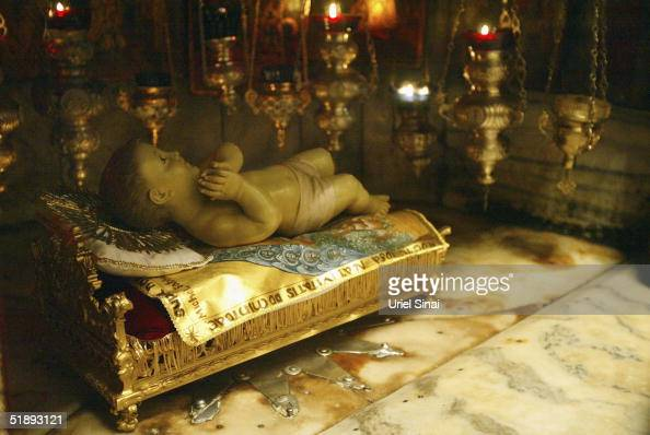The doll representing the Infant Jesus lies in a gilded crib on the Star of the Grotto of the Church of the Nativity the traditional spot of Jesus's...