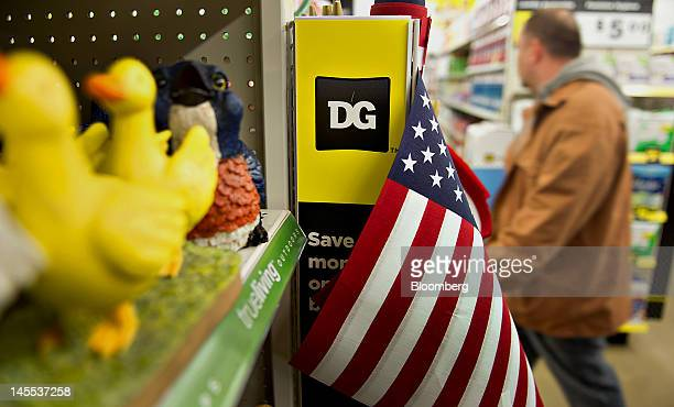 The Dollar General Corp logo appears on a box of US flags on display at a store in Creve Coeur Illinois US on Thursday May 31 2012 US consumer...