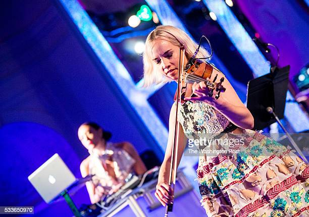 The Dolls Electric Violinist Caitlin Moe and DJ Mia Moretti perform at the Washington National Opera Ball at the Organization of American States on...