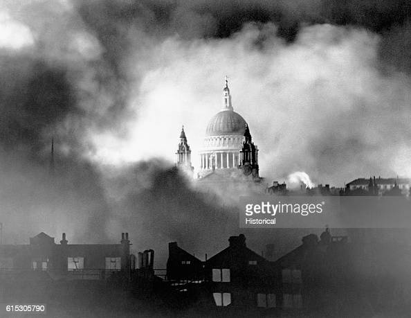 The dome of St Paul's Cathedral stands untouched among flames and smoke from surrounding buildings during the great Luftwaffe fire raid of Sunday...