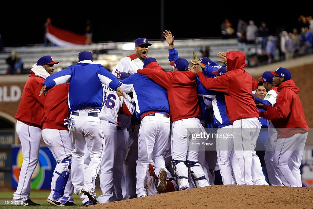 The Dominican Republic celebrates after defeating the Netherlands by a score of 4-1 to win the semifinal of the World Baseball Classic at AT&T Park on March 18, 2013 in San Francisco, California.