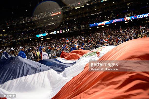 The Dominican Republic celerbates with the trophy after defeating Puerto Rico to win the Championship Round of the 2013 World Baseball Classic by a...
