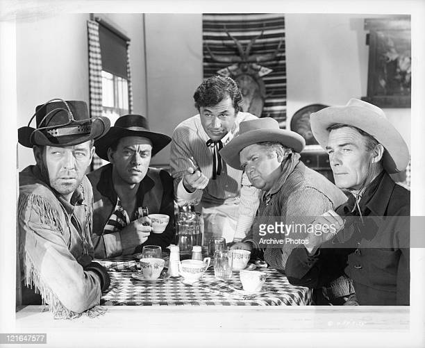 Frank Fenton John Ireland Noah Beery Jr Charles Kemper and Randolph Scott spot a US Marshall on their trail in a scene from the film 'The Great...