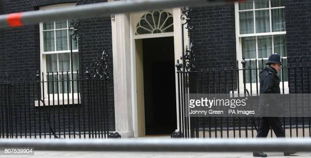 The door of 10 Downing Street stands ajar in Westminster central London as General Election polling day approaches