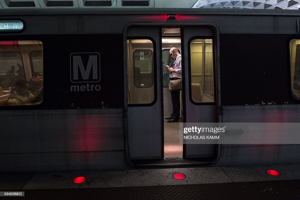 The door of a Metro train closes before departing the L'Enfant Plaza station in Washington, DC, on May 24, 2016. Paul Wiedefeld, who used to run the Baltimore-Washington international airport, took over as Metrorail's new general manager in November 2015, assuming what was probably the least wanted job in the city at a really tense time. Wiedefeld has since presented a long-term maintenance plan to improve the system. / AFP / Nicholas Kamm
