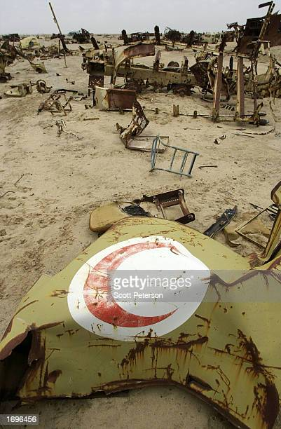 The door of an Iraqi military medical vehicle lies in a graveyard with Iraqi tanks destroyed during the 1991 Gulf War just north of Iraq's border...