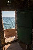 The door of no return in one of the slave houses on Goree Island in the Atlantic Ocean outside of Dakar in Senegal West Africa