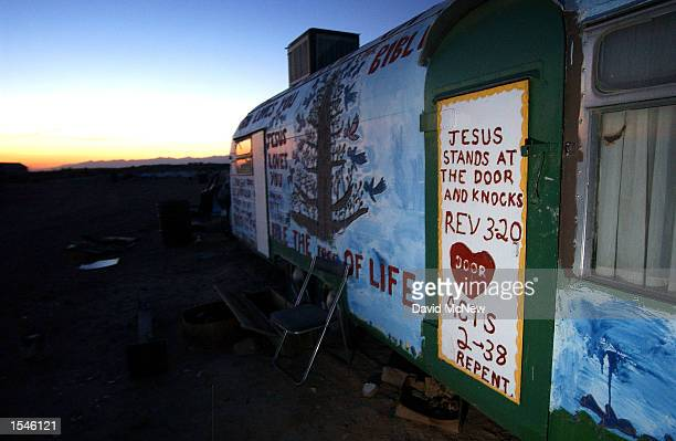 The door on a trailor quotes the Biblical books of Revelations and Acts on the grounds of Salvation Mountain May 30 2002 near Niland CA east of the...
