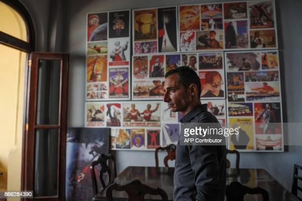 The doorman of the retroSoviet restaurant Nazdarovie Dimitri Fidel is pictured at the restaurant in Havana on October 16 2017 With three decades of...
