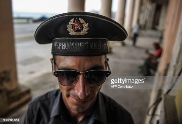 The doorman of the retroSoviet restaurant Nazdarovie Dimitri Fidel shows his hat in Havana on October 16 2017 With three decades of close alliance...