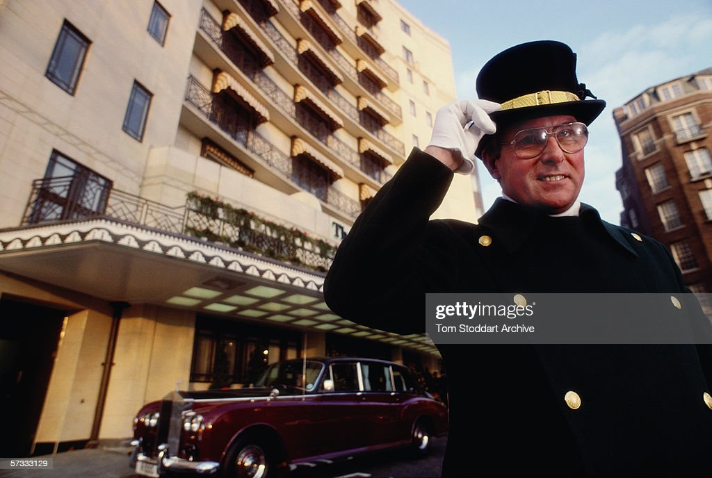 The doorman outside the Dorchester Hotel. The Dorchester Hotel on London's Park Lane opened its doors on April 18th 1931. Since then the name has become synonymous with luxury, style and glamour. Hollywood actors have particuarly enjoyed its special glitzy comfort, Richard Burton, Elizabeth Taylor, James Mason, Yul Bryner, Julie Andrews, Warren Beatty, Peter Sellers, Tom Cruise and Arnold Schwarzenegger have all fallen in love with the hotel's unique atmosphere.