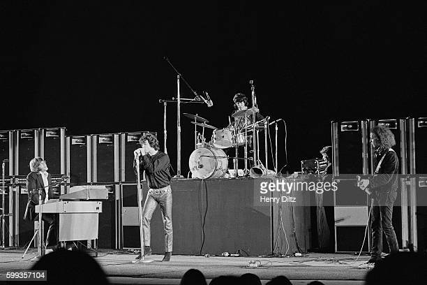 The Doors perform during a concert at the Hollywood Bowl in Los Angeles California From left to right Keyboardist Ray Manzarek singer Jim Morrison...