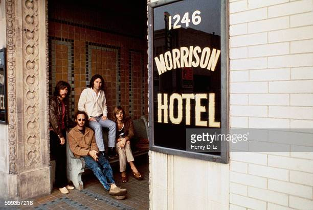 The Doors sit outside the Morrison Hotel in Los Angeles during a photo shoot for their 1970 Morrison Hotel album Left to right are John Densmore...