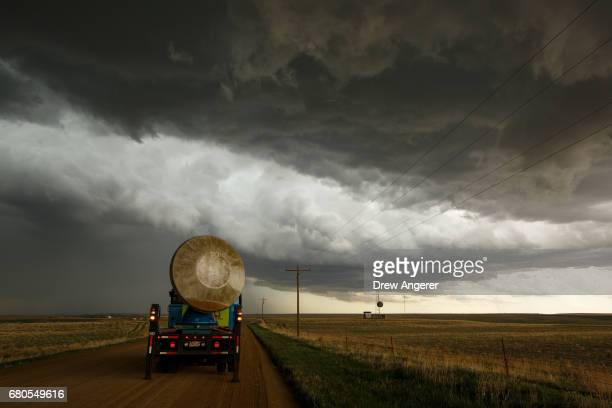 The Doppler on Wheels vehicle scans a supercell thunderstorm during a tornado research mission May 8 2017 in Elbert County near Agate Colorado...