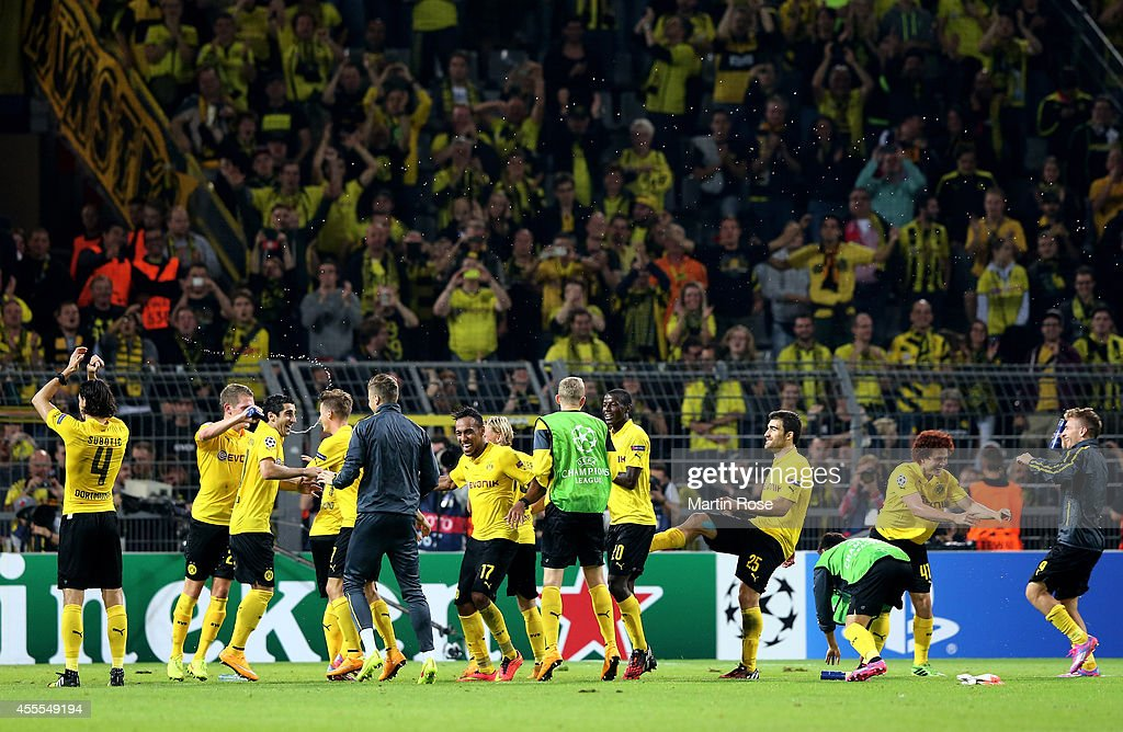The Dortmund players celebrate their 2-0 victory during the UEFA Champions League Group D match between Borussia Dortmund and Arsenal at Signal Iduna Park on September 16, 2014 in Dortmund, Germany.