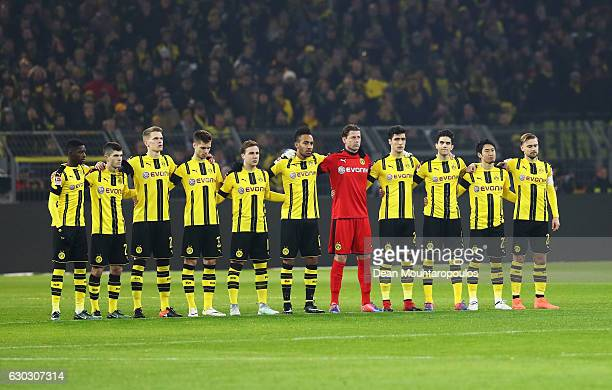 The Dortmund players observe a minute's silence to remember the victims of the Berlin attack prior to the Bundesliga match between Borussia Dortmund...