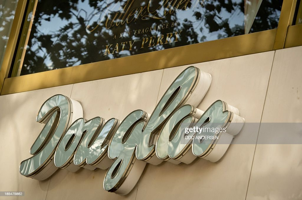 The 'Douglas' logo is seen on the facade of one of their outlets in Berlin on October 21, 2013. The German cosmetics retailer Douglas Holding is in talks to buy the French perfumery chain Nocibe in a deal that would make it France's largest branch network, according to the company's informations.