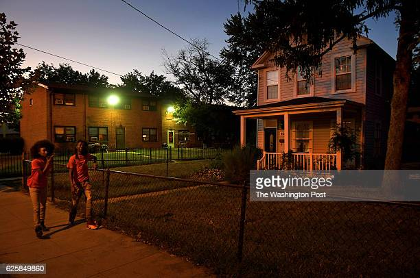 The Douglas Street home of Eduardo Laguerra is right next door to the Kenilworth Courts housing projects at left The story addresses the...