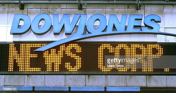 The Dow Jones news ticker in Times Square is displayed on July 31 2007 in New York City Rupert Murdoch's News Corp has reportedly secured sufficient...