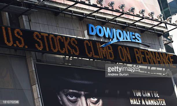 The Dow Jones newsticker in Times Square reads 'US Stocks climb on Bernanke's speech' on August 31 2012 in New York City Ben Bernanke chairman of the...