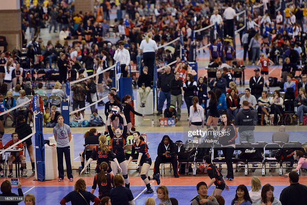 The Downstate Juniors Volleyball Club, of Peekskill, NY plays the Idaho Falls Juniors Volleyball Club, during the Colorado Crossroads National Qualifier volleyball tournament at the Colorado Convention Center in Denver, CO March 02, 2013. The event, held over two weekends, is one of nine national tournaments that lead up to the USA Junior National Girls' Volleyball Championships. Close to 700 teams will play on 89 courts through the weekend.