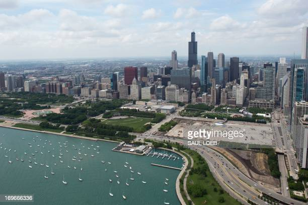 The downtown Chicago skyline and Lake Michigan are seen in this aerial photograph over Chicago Illinois May 30 2013 AFP PHOTO / Saul LOEB