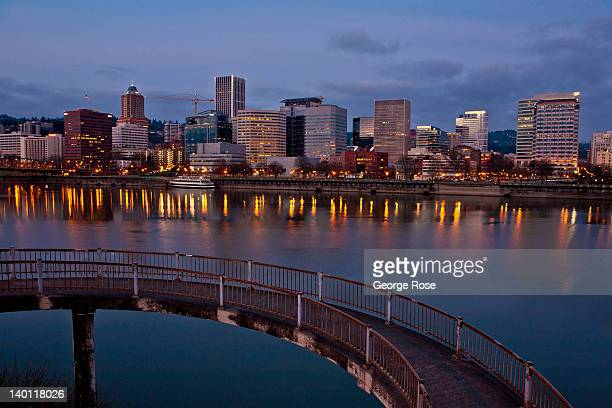 The downtown skyline and an Eastbank Esplanade walkway are viewed in the early morning on February 11 in Portland Oregon Portland has embraced its...