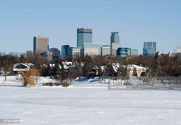 The downtown skyline is seen from across Lake Calhoun after a snow storm December 12 2010 in Minneapolis Minnesota A blizzard dumped more than 20...