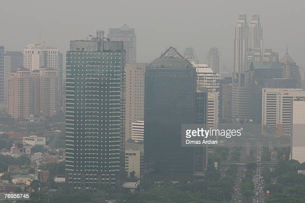The downtown skyline of capital Jakarta Indonesia obscured by the pollution is seen on the day before 'NoCar Day' is held in Jakarta September 21...