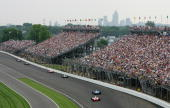 The downtown skyline overlooks the track during the IRL Indycar Series 91st running of the Indianapolis 500 at the Indianapolis Motor Speedway May 27...