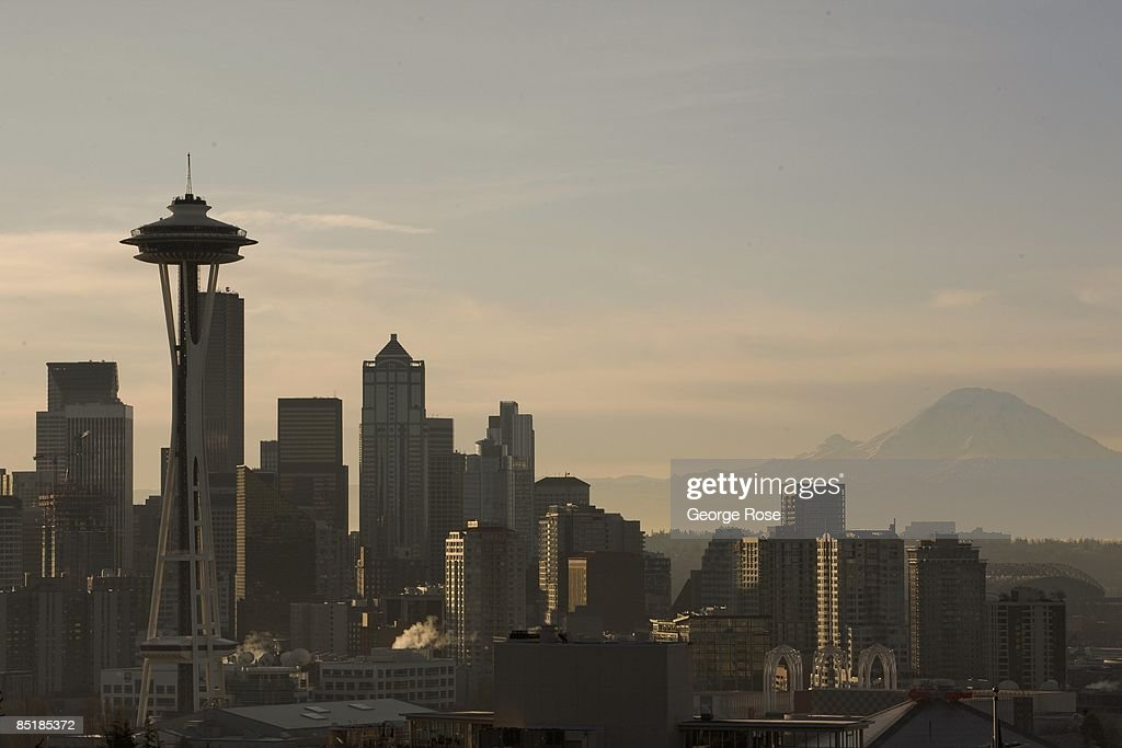 The downtown skyline, Space Needle and Mount Rainier is seen in this 2009 Seattle, Washington, early morning city landscape photo.