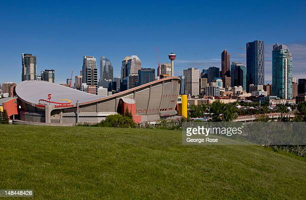 The downtown skyline the Saddledome and Stampede Park is viewed from a hill to the southeast on July 3 2012 in Calgary Canada Calgary home to the...