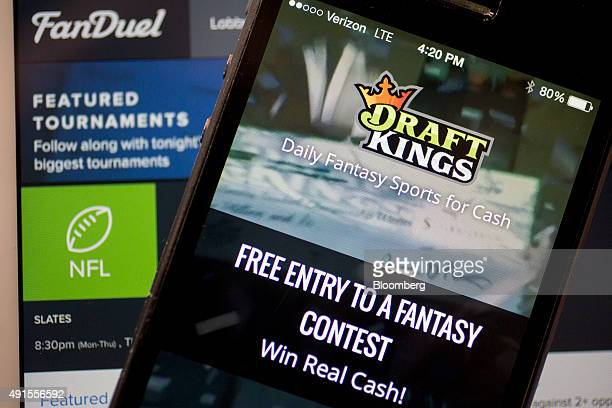 The DraftKings Inc app and FanDuel Inc website are arranged for a photograph in Washington DC US on Monday Oct 5 2015 Fantasy sports companies...