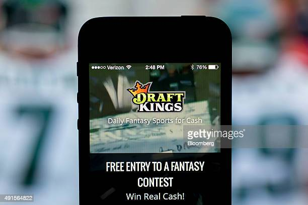 The DraftKings Inc app is arranged for a photograph on an Apple Inc iPhone in Washington DC US on Sunday Oct 4 2015 Fantasy sports companies...