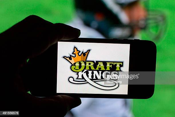 The DraftKings Inc logo is arranged for a photograph on an Apple Inc iPhone in Washington DC US on Sunday Oct 4 2015 Fantasy sports companies...