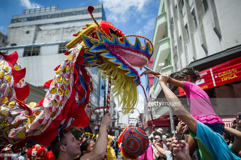 The dragon dance is performed during the Chinese lunar new year celebrations at Liberdade district in Sao Paulo, Brazil, on February 2, 2013. The Chinese lunar New Year's day will be February 10 as the year of snake in Chinese zodiac calendar. AFP PHOTO/Yasuyoshi CHIBA