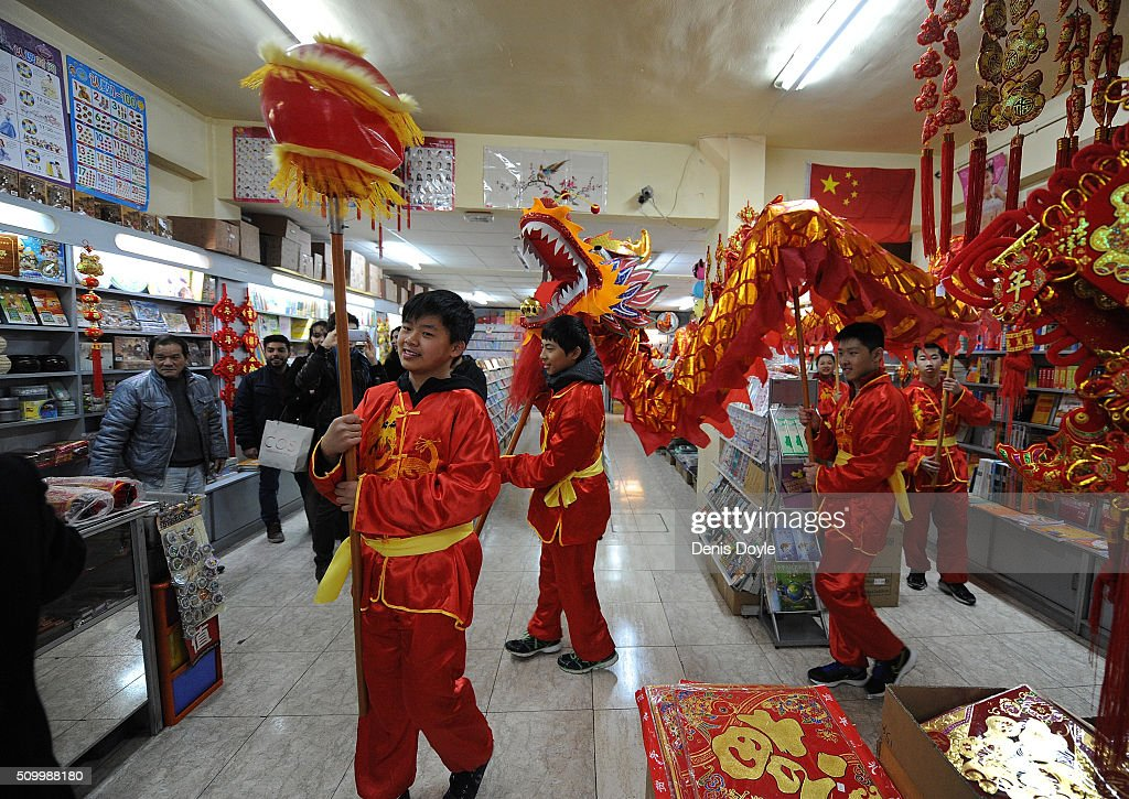 The dragon figure visits a supermarket to give good luck for the lunar new year during the procession to celebrate The Year of The Monkey on February 13, 2016 in Madrid, Spain. The Madrid Town Hall has organised this year's Chinese New Year for the first time in Madrid's Chinatown district of Usera.