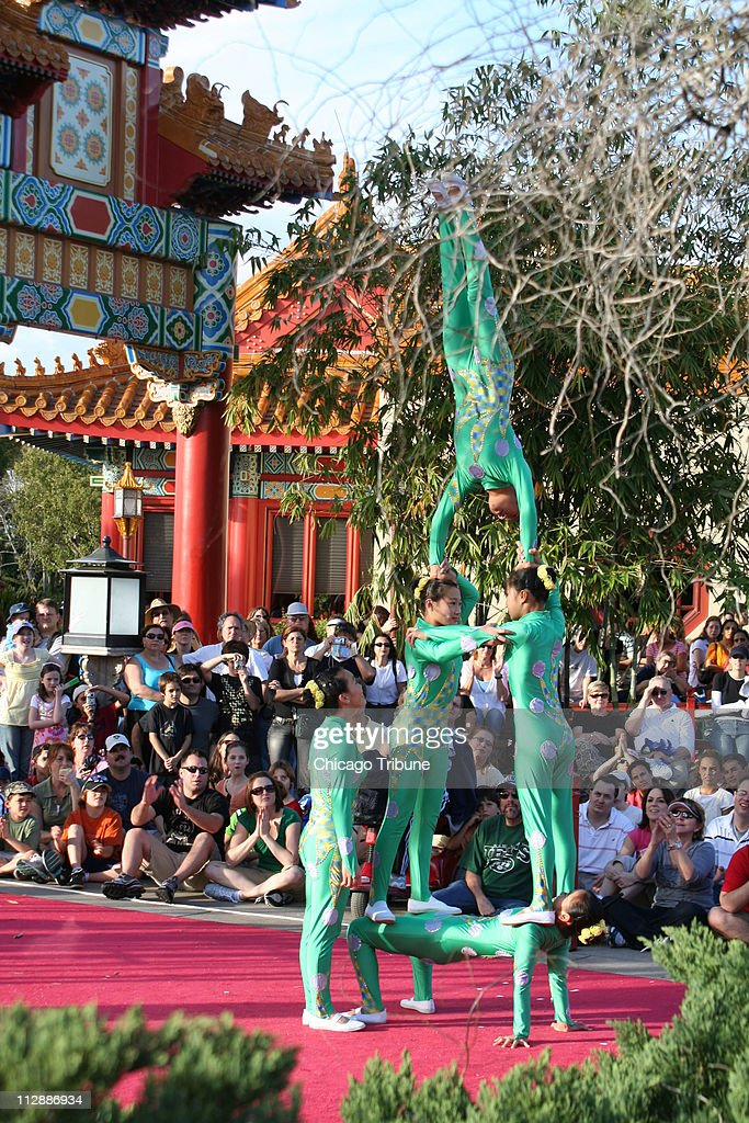 The Dragon Legend Acrobats treat the crowd to a free and unforgettable show at Epcot's China Pavilion in Orlando Florida