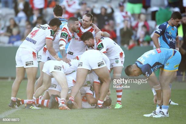 The Dragons celebrate a try scored by Cameron McInnes of the Dragons during the round 23 NRL match between the St George Illawarra Dragons and the...
