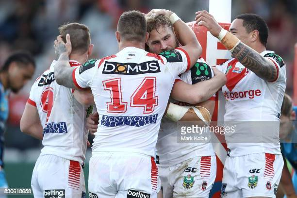 The Dragons celebrate a try scored by Kurt Mann of the Dragons during the round 23 NRL match between the St George Illawarra Dragons and the Gold...
