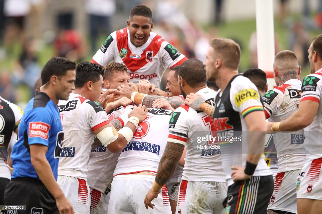 The Dragons celebrate with Jack de Belin after he scored a try during the round one NRL match between the St George Illawarra Dragons and the Penrith Panthers at UOW Jubilee Oval on March 4, 2017 in Sydney, Australia.