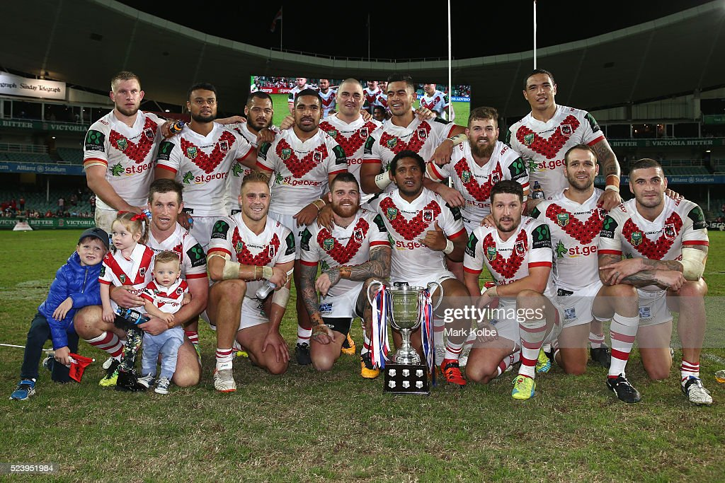 The Dragons pose with the ANZAC trophy after victory during the round eight NRL match between the St George Illawarra Dragons and the Sydney Roosters at Allianz Stadium on April 25, 2016 in Sydney, Australia.